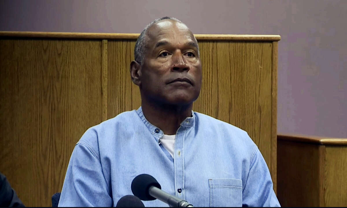 CORRECTS SOURCE TO KOLO-TV - Former NFL football star O.J. Simpson appears via video for his parole hearing at the Lovelock Correctional Center in Lovelock, Nev., on Thursday. Simpson was convicted in 2008 of enlisting some men he barely knew, including two who had guns, to retrieve from two sports collectibles sellers some items that Simpson said were stolen from him a decade earlier.