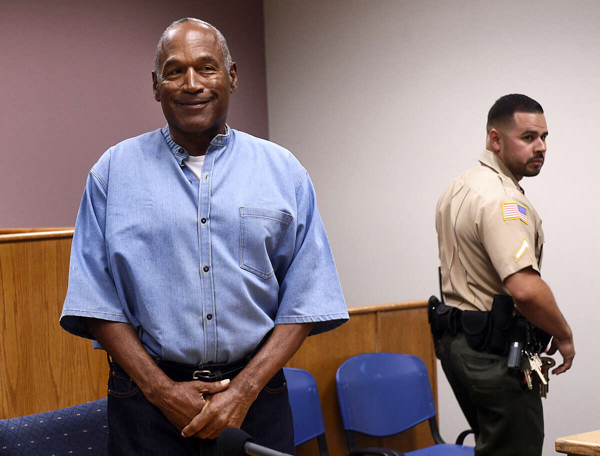 Former NFL football star O.J. Simpson enters for his parole hearing at the Lovelock Correctional Center in Lovelock, Nev., on Thursday. Simpson was convicted in 2008 of enlisting some men he barely knew, including two who had guns, to retrieve from two sports collectibles sellers some items that Simpson said were stolen from him a decade earlier.