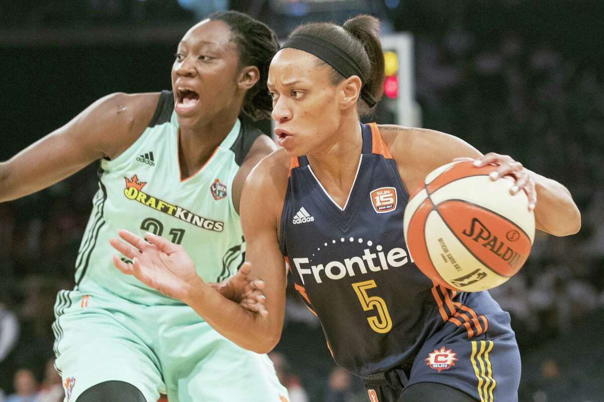 Connecticut Sun guard Jasmine Thomas, right, drives to the basket against Liberty center Tina Charles during a recent game.