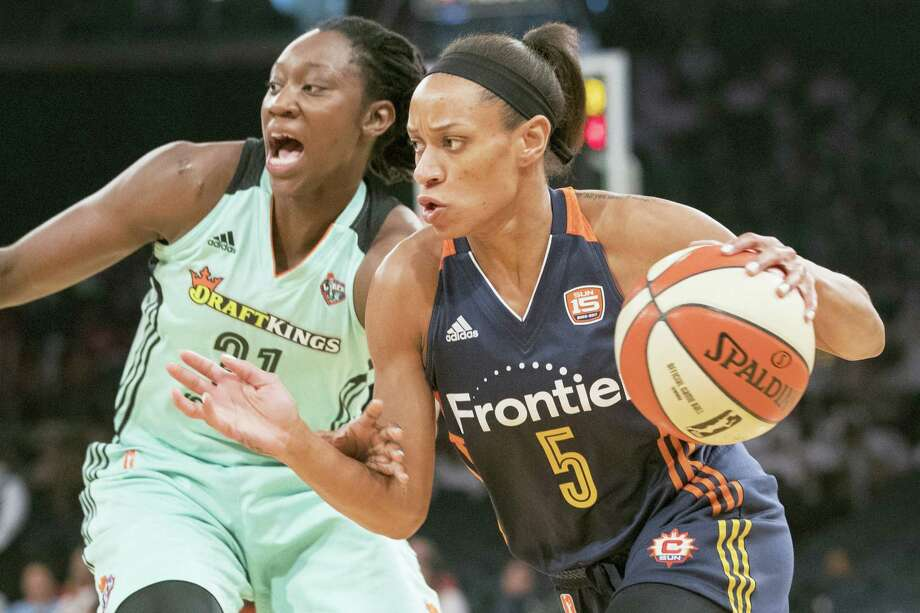 Connecticut Sun guard Jasmine Thomas, right, drives to the basket against Liberty center Tina Charles during a recent game. Photo: Mary Altaffer — The Associated Press  / Copyright 2017 The Associated Press. All rights reserved.