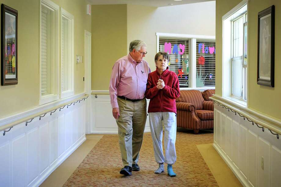 Bill Harris walks with his wife, Nora, at a memory care center in Medford, Ore. Nora Harris, 64, has Alzheimer's and her family claims a law is forcing her to be spoon-fed against her wishes.  Photo: Jim Craven, HO / KHN