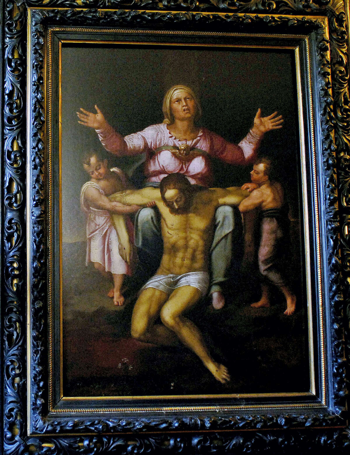 In this Oct. 13, 2010, file photo, a framed copy of a painting, believed by its owner to be the work of Michelangelo in the 16th century, is displayed by Martin Kober in his Tonawanda, N.Y, home. Kober expected skepticism when he set out to prove that a painting that hung in his boyhood home in upstate New York really is an authentic Michelangelo worth as much as $300 million. What he didn't anticipate was the art world's continued reluctance to consider the possibility after spending years compiling forensic and documentary evidence.