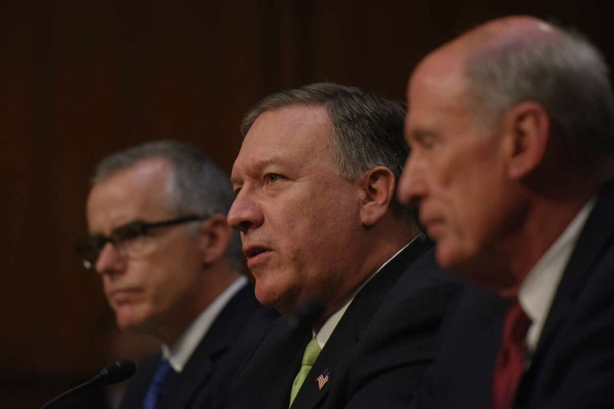 From left, acting FBI director Andrew McCabe, CIA Director Mike Pompeo and Director of National Intelligence Daniel Coats are questioned at a Senate hearing on May 11.