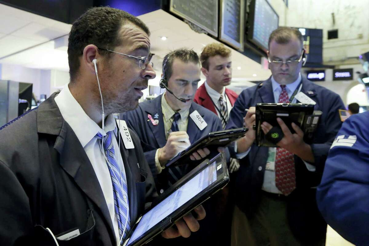 Richard Scardino, left, works with fellow traders on the floor of the New York Stock Exchange Thursday.