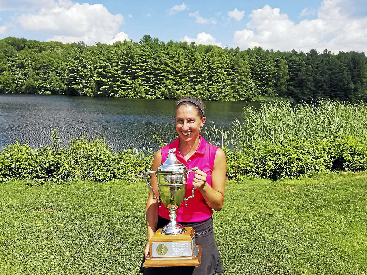 Joe Morelli - Hearst Connecticut Media Autumn Serruta holds the trophy after winning the 52nd Connecticut Women's Amateur championship Wednesday.