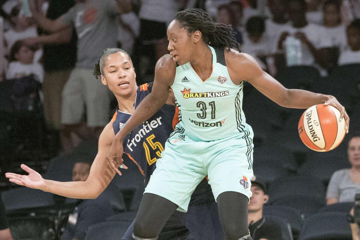New York Liberty center Tina Charles (31) drives to the basket against Connecticut Sun forward Alyssa Thomas