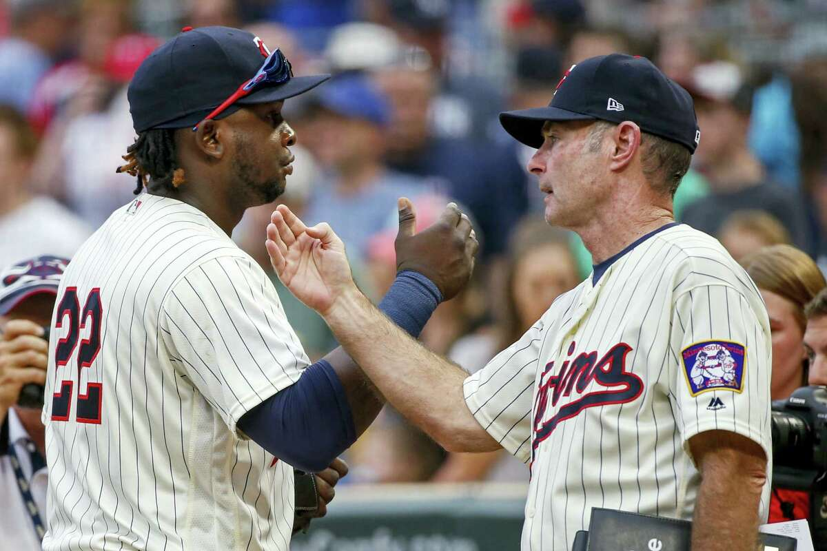 Minnesota Twins third baseman Miguel Sano, left, celebrates the 6-1 win over the New York Yankees with manager Paul Molitor after a baseball game on Wednesday, in Minneapolis.
