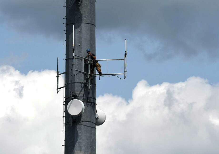 Antennas for a backup radio system for the Rensselaer County emergency dispatch center are installed at the Rensselaer County Public Safety Building on Friday, Aug. 25, 2017, in Troy, N.Y. The countyÕs dispatch center has undergone a major update. A first responder Home Alerting pager system has just come online. The enhanced radio system and upgrades, which are slated to be fully operational in October, are expected to cost $21 million. (Will Waldron/Times Union) Photo: Will Waldron, Albany Times Union / 20041389A
