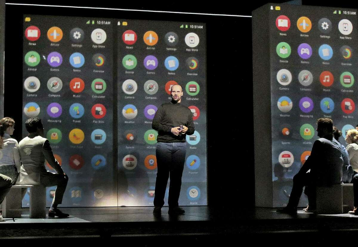 """This image released by the Santa Fe Opera shows Edward Parks as Steve Jobs in Santa Fe Opera's world premiere of Mason Bates and Mark Campbell's opera, """"The (R)evolution of Steve Jobs,"""" in Santa Fe, N.M."""