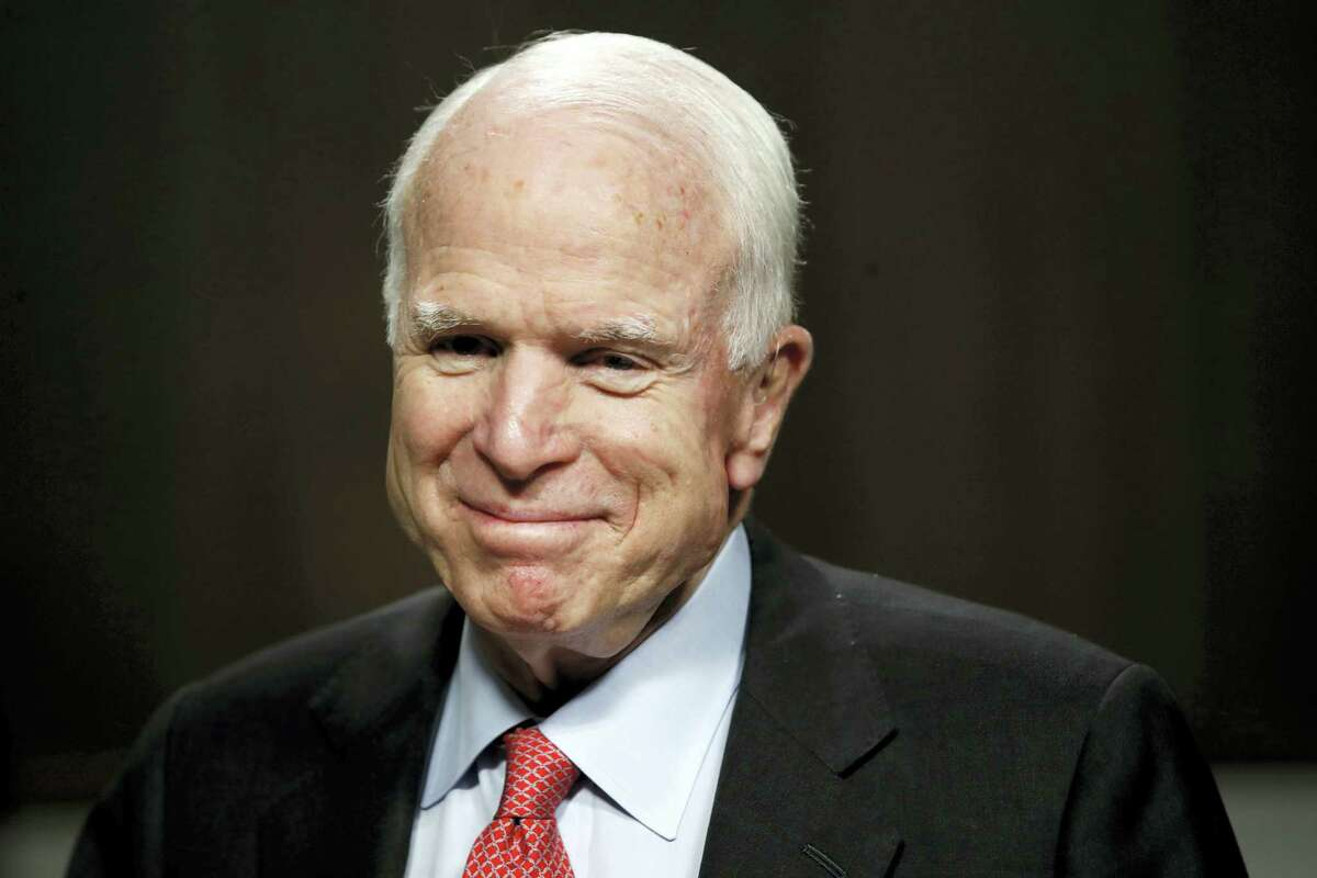 In this July 11, 2017, file photo, Sen. John McCain, R-Ariz., arrives on Capitol Hill in Washington. McCain has been diagnosed with a brain tumor after a blood clot was removed.