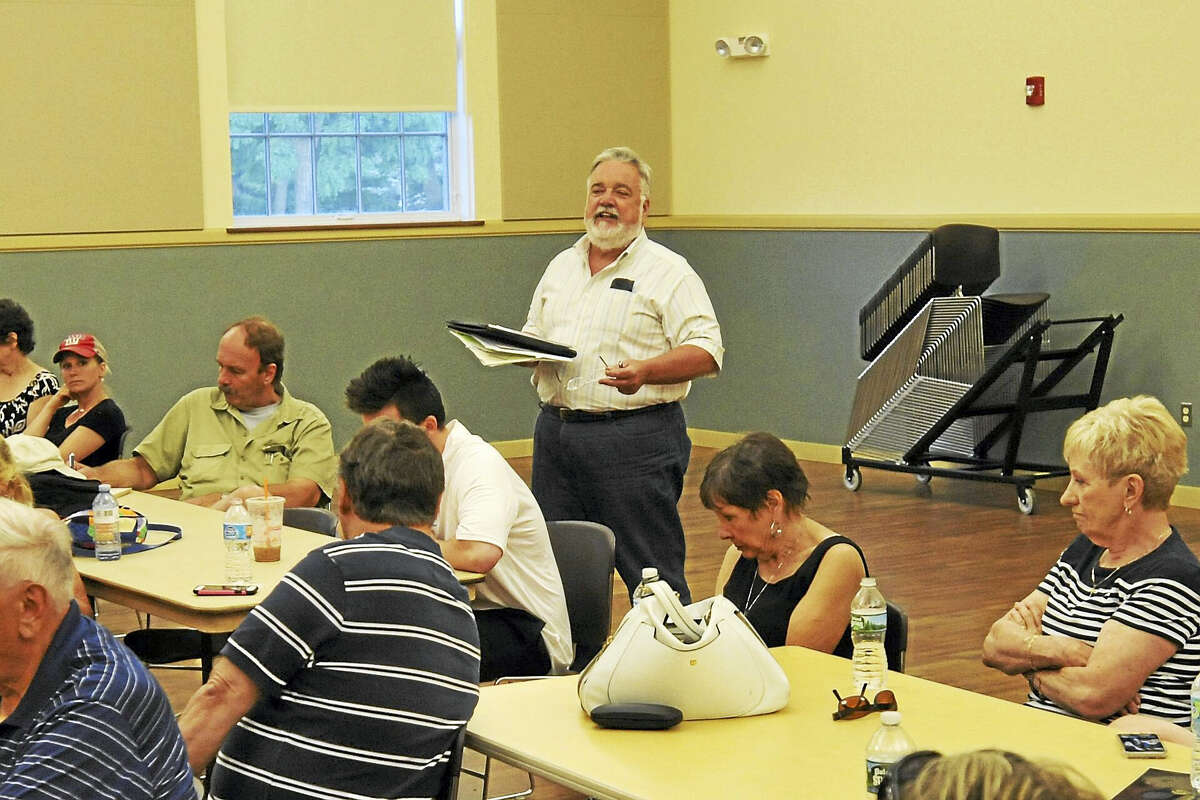 The Torrington Democrats endorsed candidates to run in the upcoming municipal election Wednesday evening. Above, nominating committee Chairman Jack Dillon speaks during the caucus.