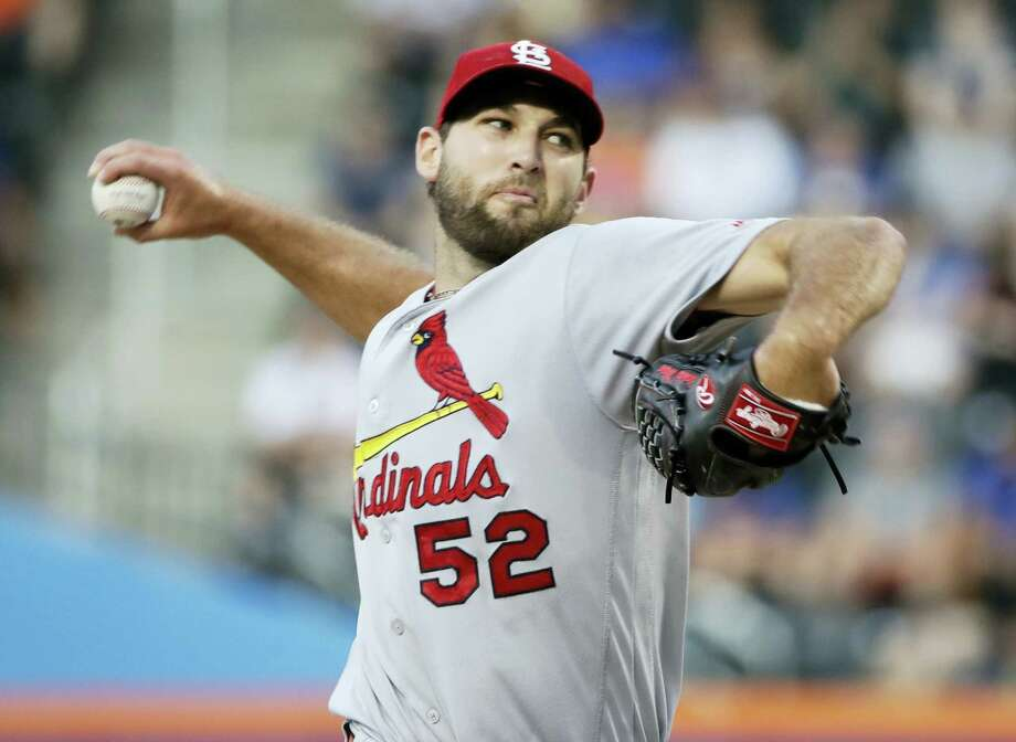 St. Louis Cardinals' Michael Wacha winds up during the first inning against the New York Mets on Tuesday. Wacha tossed a three-hit shutout to beat the Mets 5-0. Photo: FRANK FRANKLIN II — THE ASSOCIATED PRESS  / Copyright 2017 The Associated Press. All rights reserved.