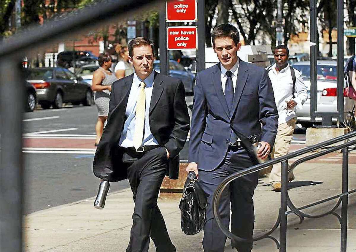 Prosecutors Chris Mattei, left, and Liam Brennan, enter the Federal Courthouse after a break during day three in the John Rowland trial in downtown New Haven on Sept. 5, 2014.