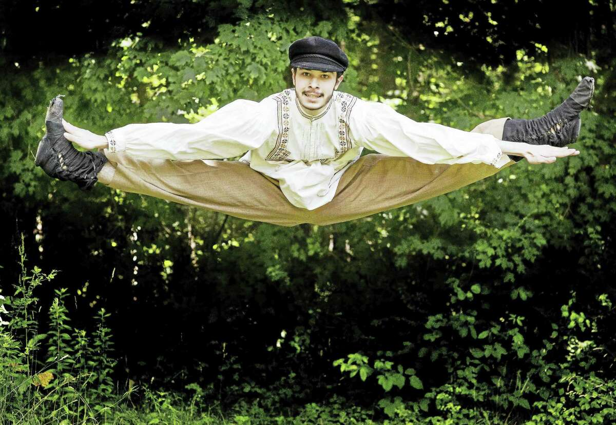"""Actor Noah Pyzik does a split leap during a rehearsal for """"Fiddler on the Roof"""" opening July 29. The Clay & Wattles Theater Company production is being held at The Gary The Olivia Theater in Bethlehem."""