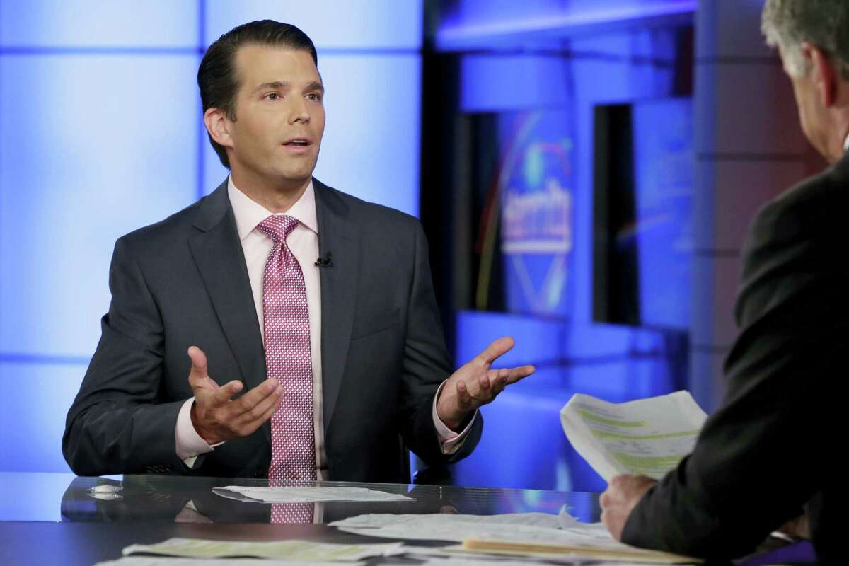 In this July 11, 2017 file photo, Donald Trump Jr., left, speaks in New York. A lawyer for a Russian developer says a company representative was the eighth person at a Trump Tower meeting brokered by Donald Trump Jr. during the campaign.
