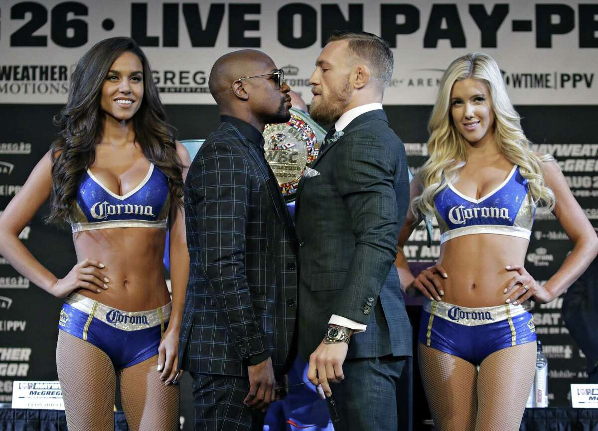 Floyd Mayweather Jr. (left) and Conor McGregor pose for photos during the last press conference promoting their fight on Aug. 23, 2017, in Las Vegas.