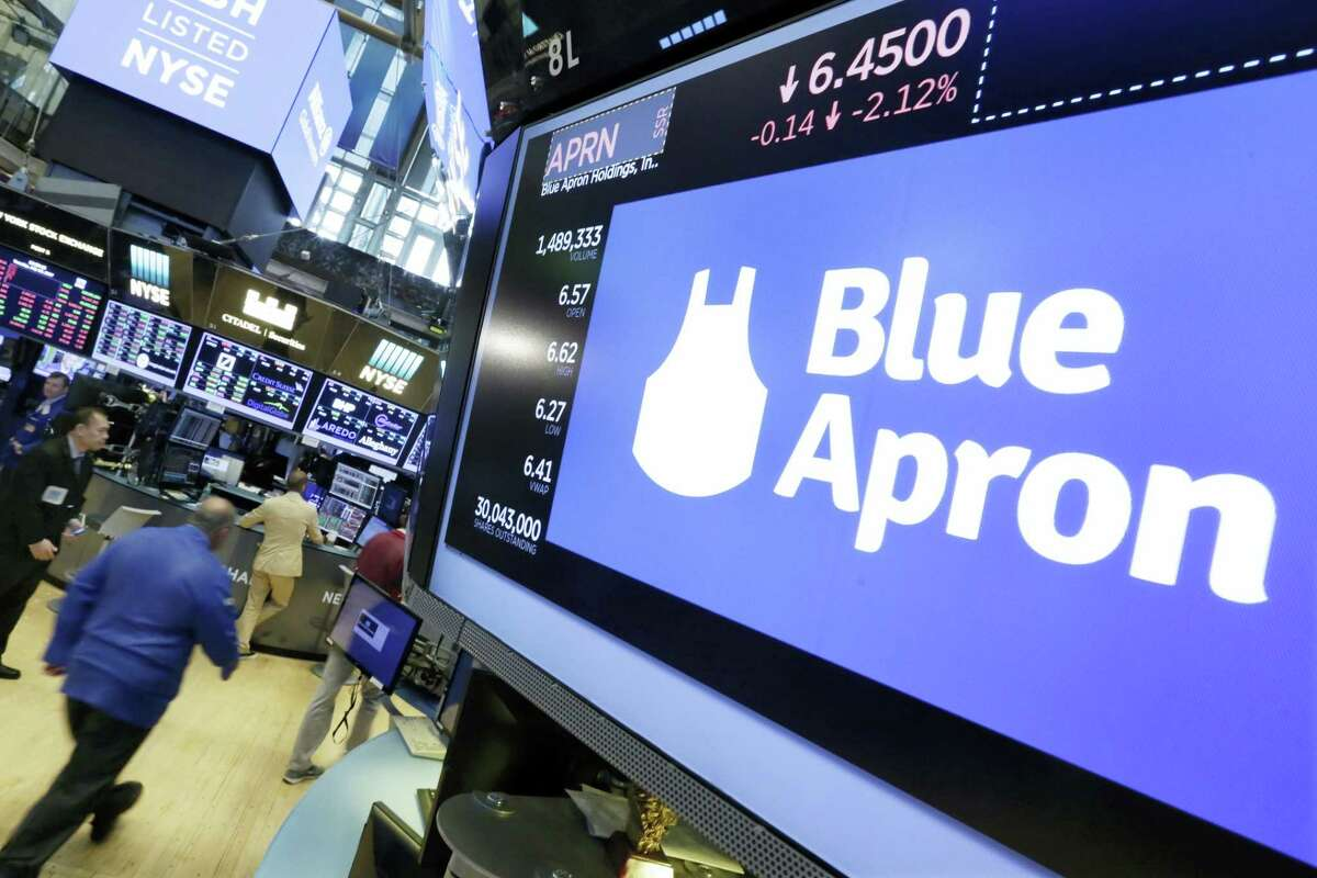 The Blue Apron logo appears above a trading post on the floor of the New York Stock Exchange, Tuesday, July 18, 2017. The meal kit company tumbled after The Sunday Times reported that Amazon is getting ready to launch its own meal-prep business.