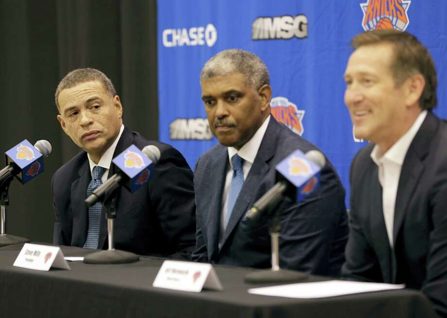 Knicks general manager Scott Perry, left, and president Steve Mills, center, look on as head coach Jeff Hornacek speaks during a news conference in Tarrytown, N.Y., on Monday. Photo: Seth Wenig — The Associated Press  / Copyright 2017 The Associated Press. All rights reserved.