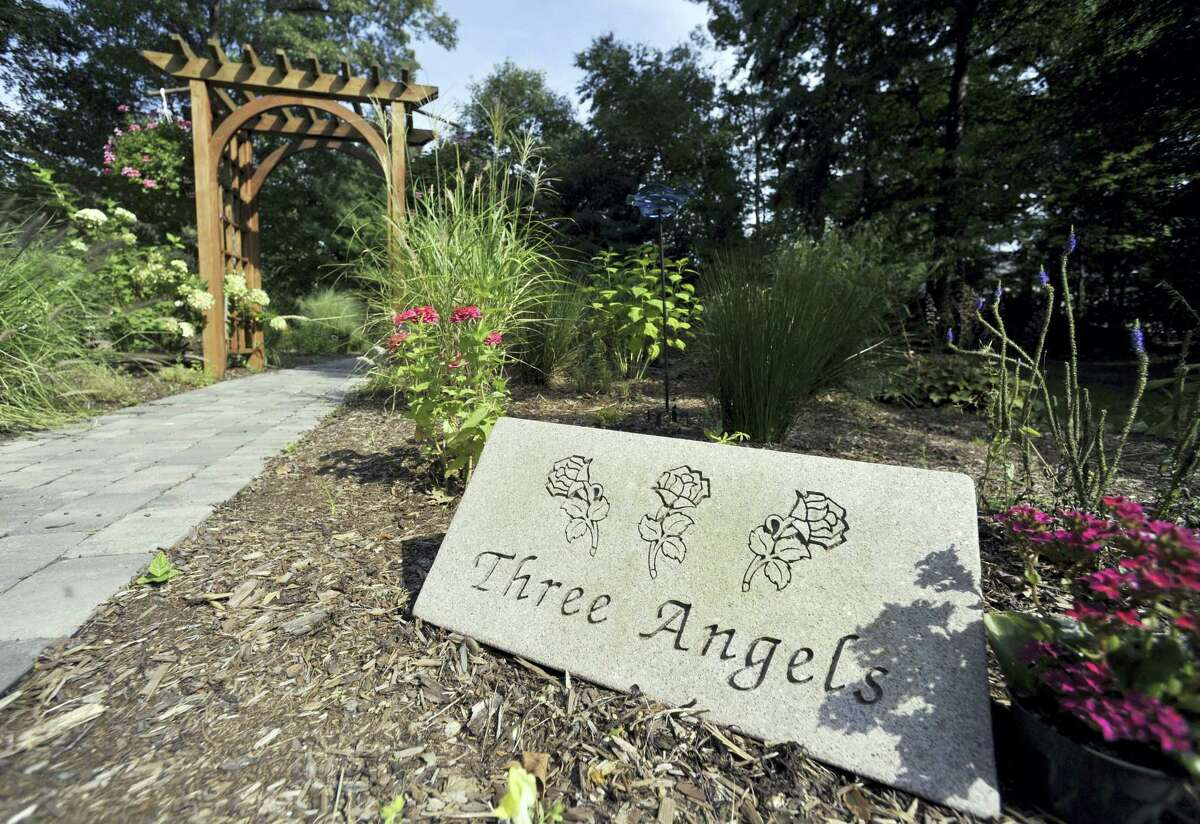 In this Sept. 7, 2010 photo, a remembrance garden is in place where the house of the William Petit family once stood in Cheshire, Conn. Petit's wife Jennifer Hawke-Petit and daughters Hayley and Michaela were killed there during a home invasion in July 2007
