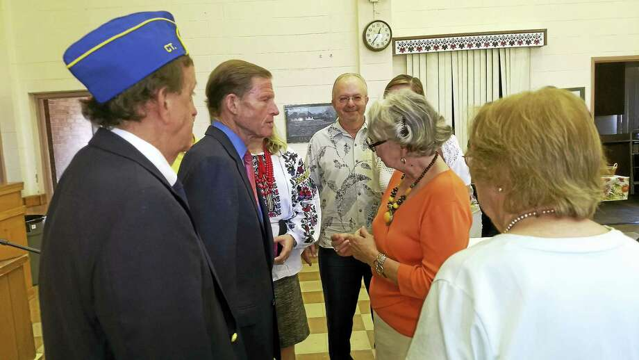 U.S. Sen. Richard Blumenthal chats with Anya Rohmer-Hanson following his talk after church at St. Michael's Sunday regarding initiatives to help Ukraine and it's soldiers in their fight with Russia. Photo: Pam McLoughlin / Hearst Connecticut Media
