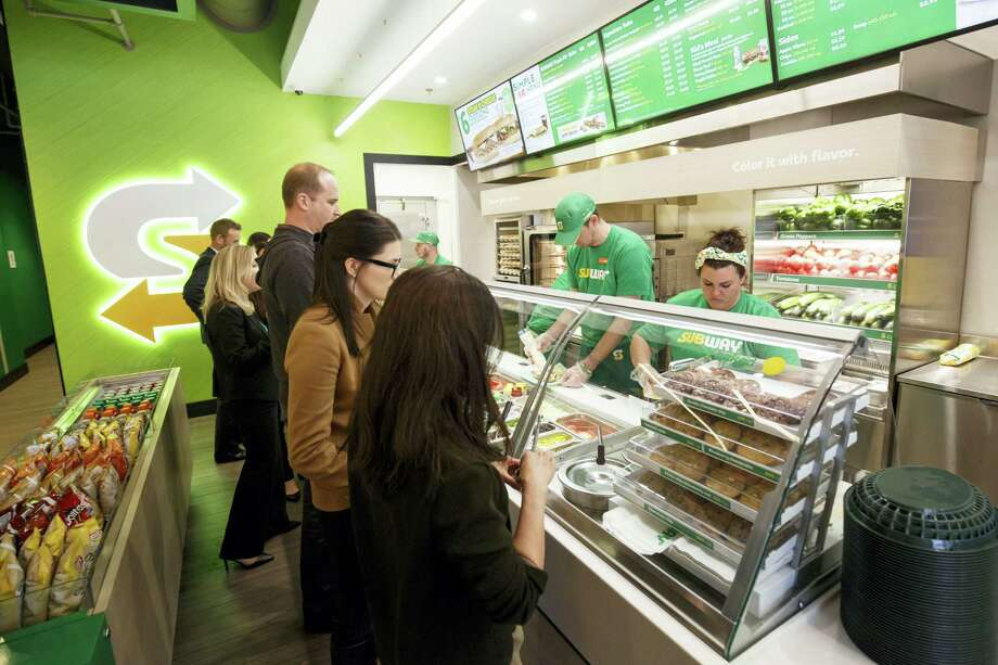 This January 2017 photo provided by Subway shows the interior of a remodeled Subway store in Knoxville, Tenn. Subway is looking to update the look of its stores as the chain's U.S. sales have been declining. The company says the redesign, which includes a brighter atmosphere, displays of vegetables behind the counter and ordering tablets, is the first major revamp since the early 2000s. (Chris Radcliffe/Subway via AP) Photo: AP / Subway
