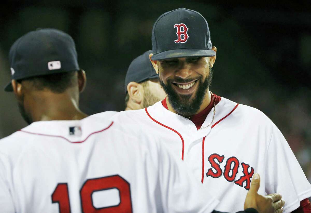 David Price, right, congratulates Jackie Bradley Jr. (19) after Bradley's catch on a fly out by Aaron Judge during the eighth inning of the second game of doubleheader in Boston, on Sunday.)