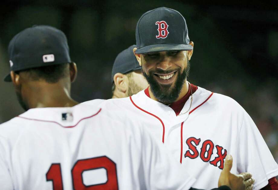 David Price, right, congratulates Jackie Bradley Jr. (19) after Bradley's catch on a fly out by Aaron Judge during the eighth inning of the second game of doubleheader in Boston, on Sunday.) Photo: Michael Dwyer — The Associated Press  / Copyright 2017 The Associated Press. All rights reserved.
