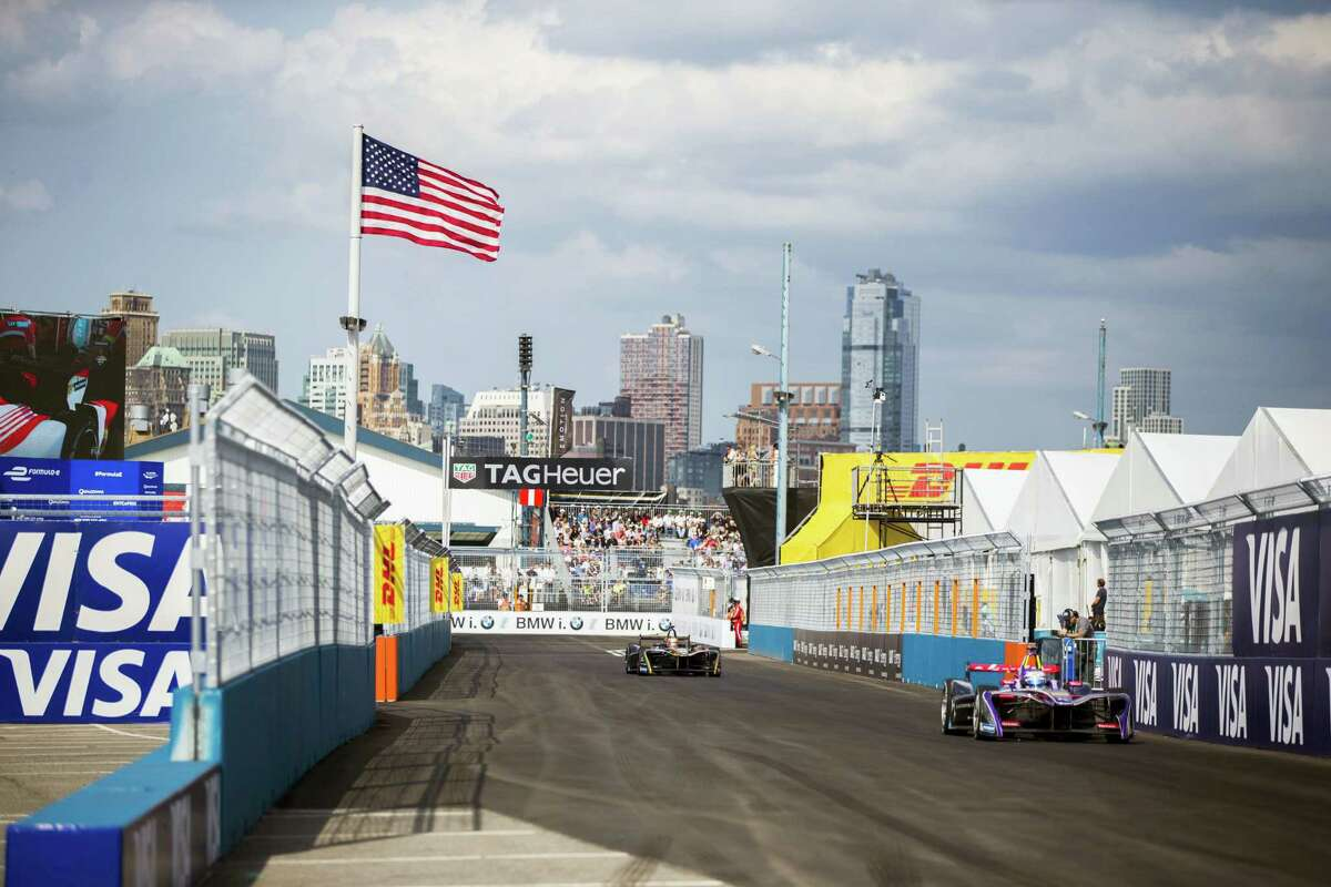 Sam Bird, right, drives during the Formula E all-electric New City ePrix Saturday in Brooklyn.