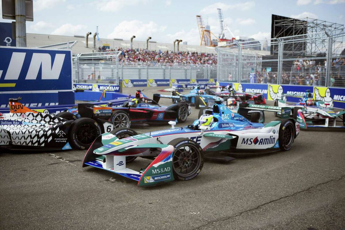 Drivers head through a corner at the start of the New York City ePrix a Formula E all-electric race on Saturday.