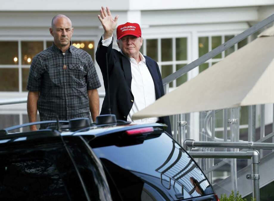 President Donald Trump waves as he leaves his presidential viewing stand on July 15, 2017 during the U.S. Women's Open Golf tournament at Trump National Golf Club in Bedminster, N.J. Photo: AP Photo — Carolyn Kaster  / Copyright 2017 The Associated Press. All rights reserved.
