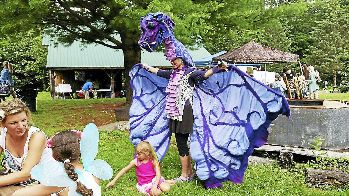 N.F. Ambery photo Puppeteer Robin McCahill dressed as a dragon and as a unicorn at various times during the sixth annual Flanders Forest Faeries & Woodland Wizards Festival.