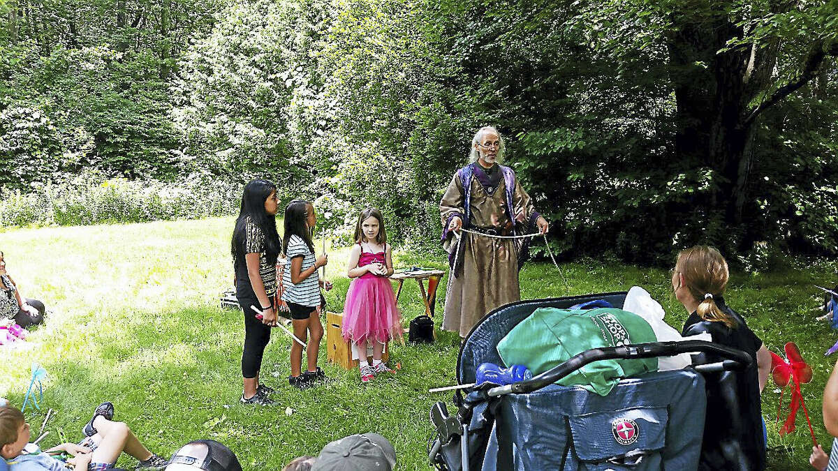 N.F. Ambery photo Cyril the Sorcerer enlisted the help of three young assistants from the audience to help with his environmentally-friendly-themed magic act.