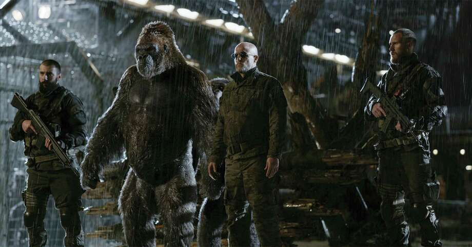 "This file image released by Twentieth Century Fox shows Woody Harrelson, center, in a ""War for the Planet of the Apes"" scene. ""War for the Planet of the Apes"" took down ""Spider-Man: Homecoming"" at the North American box office, opening with an estimated $56.5 million in ticket sales, according to information available Sunday, July 16, 2017. Photo: Twentieth Century Fox Via AP, File  / TM & © 2017 Twentieth Century Fox Film Corporation. All Rights Reserved. Not for sale or duplication."