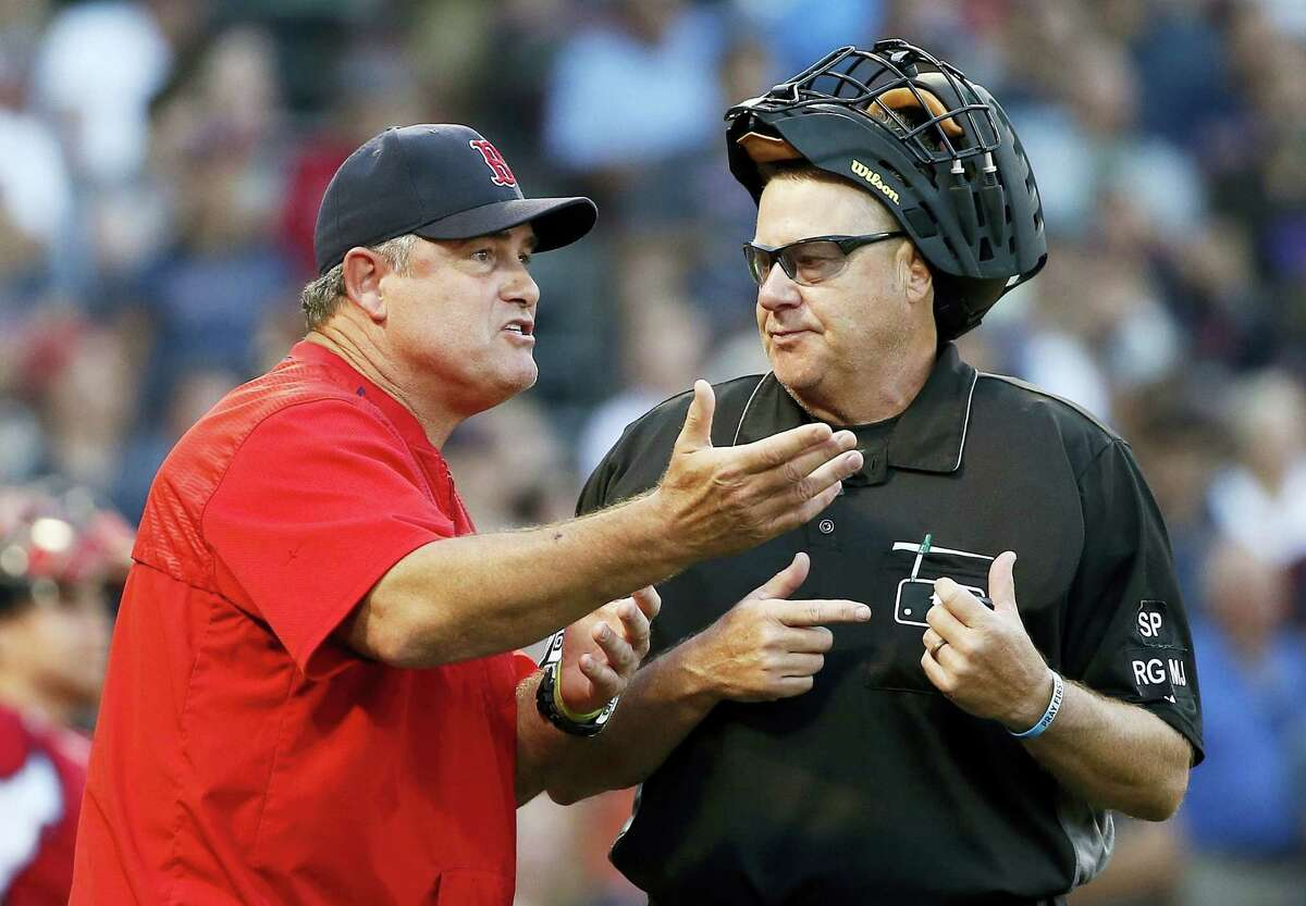 Red Sox manager John Farrell argues with home plate umpire Gary Cederstrom in the 11th inning.