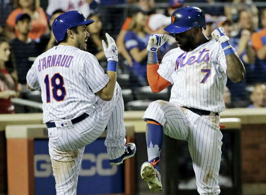 The Mets' Travis d'Arnaud, left, celebrates with Jose Reyes after Reyes hit a home run in the eighth inning Saturday in New York. Photo: Frank Franklin II — The Associated Press  / Copyright 2017 The Associated Press. All rights reserved.
