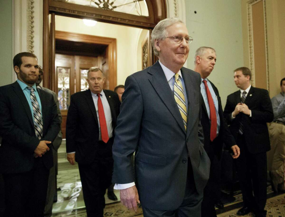 Senate Majority Leader Mitch McConnell of Ky. leaves the Senate chamber on Capitol Hill in Washington, Thursday, July 13, 2017, after announcing the revised version of the Republican health care bill.