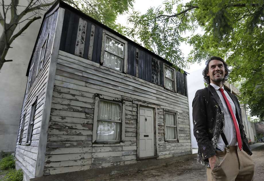 Artist Ryan Mendoza stands in front of Rosa Parks' Detroit home, which has been rebuilt in Berlin. Photo: Michael Sohn, Associated Press