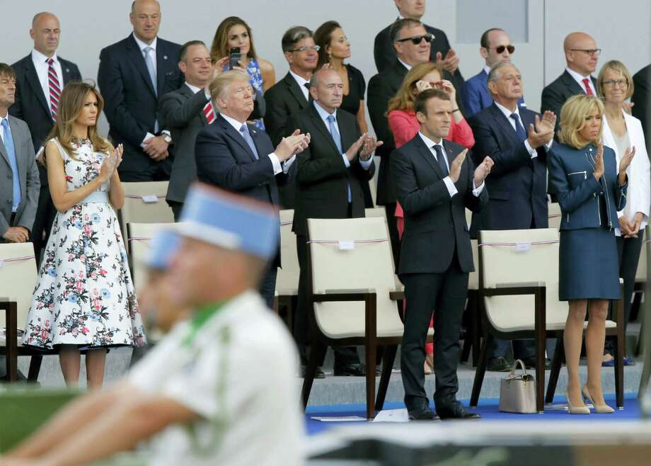 U.S. President Donald Trump: French President Emmanuel Macron, second from right; Macron's wife, Brigitte, right, and U.S. first lady Melania Trump, left, applaud as they watch the traditional Bastille Day military parade on the Champs Elysees, in Paris, Friday, July 14, 2017. Photo: AP Photo/Michel Euler   / Copyright 2017 The Associated Press. All rights reserved.