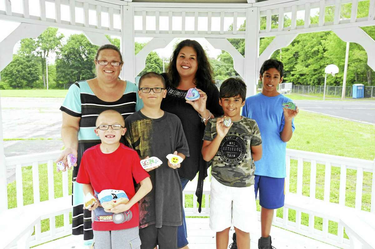 A group of residents has spent some of the summer painting and hiding rocks, bringing a bit of color and wonder to the community. From left: Dawn Styga, Zachary Styga, Joshua Styga, Stacy Rodriguez, Chase Rodriguez, and Jason Rodriguez.