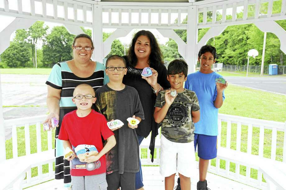A group of residents has spent some of the summer painting and hiding rocks, bringing a bit of color and wonder to the community. From left: Dawn Styga, Zachary Styga, Joshua Styga, Stacy Rodriguez, Chase Rodriguez, and Jason Rodriguez. Photo: Ben Lambert / Hearst Connecticut Media