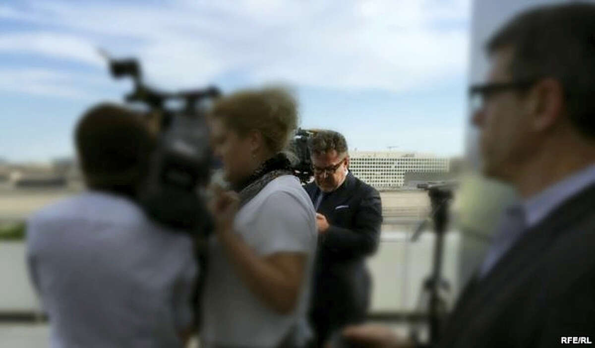 """In this photo provided by Radio Free Europe/Radio Liberty, Rinat Akhmetshin is photographed at the Newseum in Washington, June 13, 2016 after a documentary screening. Rep. Adam Schiff, ranking member on the Senate Intelligence Committee says reports that a second Russian person was in a meeting with Donald Trump Jr. last summer """"adds another deeply disturbing fact about this secret meeting."""" Akhmetshin confirmed his participation to The Associated Press on Friday, July 14, 2017."""