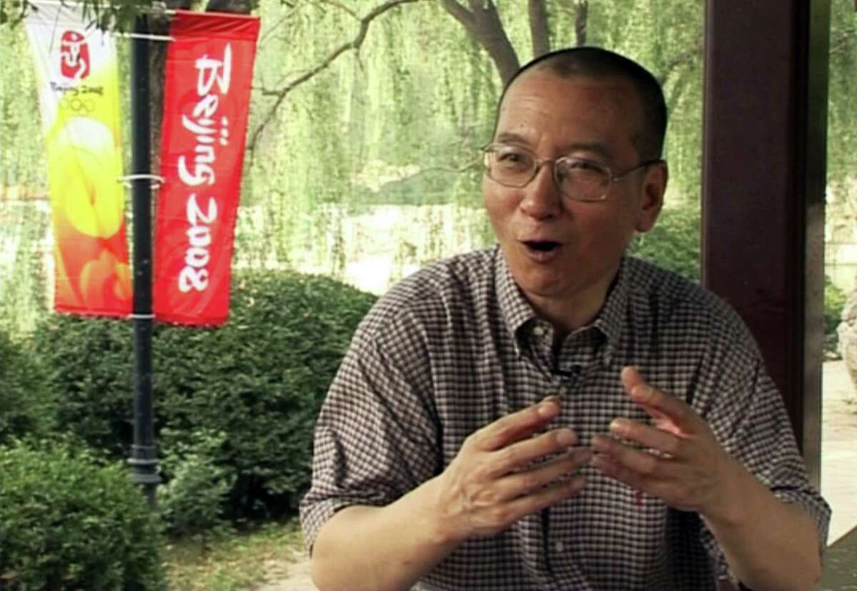 In this image taken from July 24, 2008, video footage by AP Video, Liu Xiaobo speaks during an interview at a park in Beijing, China. The judicial bureau in the northeastern Chinese city of Shenyang says jailed Nobel Peace Prize laureate Liu Xiaobo has died of multiple organ failure Thursday, July 13, 2017, at age 61. (AP Video via AP)