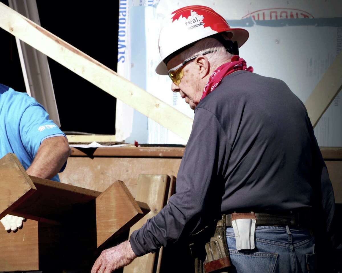 In this photo provided by the Manitoba Government, former U.S. President Jimmy Carter helps build homes for Habitat for Humanity in Winnipeg, Manitoba on Thursday, July 13, 2017. Carter was treated for dehydration while volunteering with Habitat for Humanity.