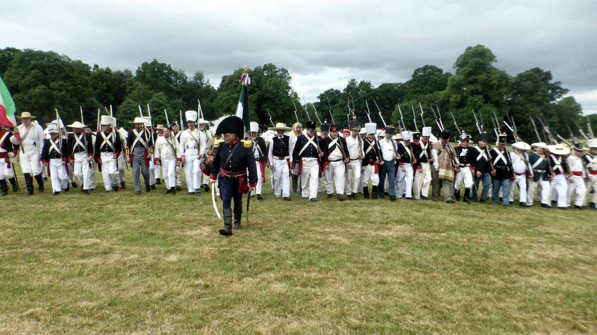 The Mexican army moves forward during the Battle of the Alamo re-enactment in June in Staffordshire, England.