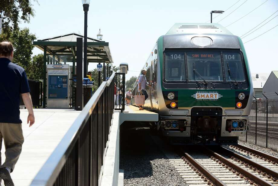 A few last minute passengers boarding on the first day of SMART train service departing from the Sonoma County Airport station Friday at 12:49 p.m. in Santa Rosa, California. Rides are free today. August 25, 2017. Photo: Erik Castro, Special To The Chronicle
