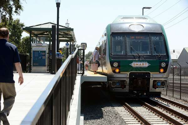 A few last minute passengers boarding on the first day of SMART train service departing from the Sonoma County Airport station Friday at 12:49 p.m. in Santa Rosa, California. Rides are free today. August 25, 2017.