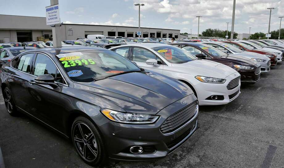 The average used car lost 17 percent of its value in the past 12 months, dropping from $18,400 to $15,300, according to an auto analytics company.  Photo: Chris O'Meara, STF / AP