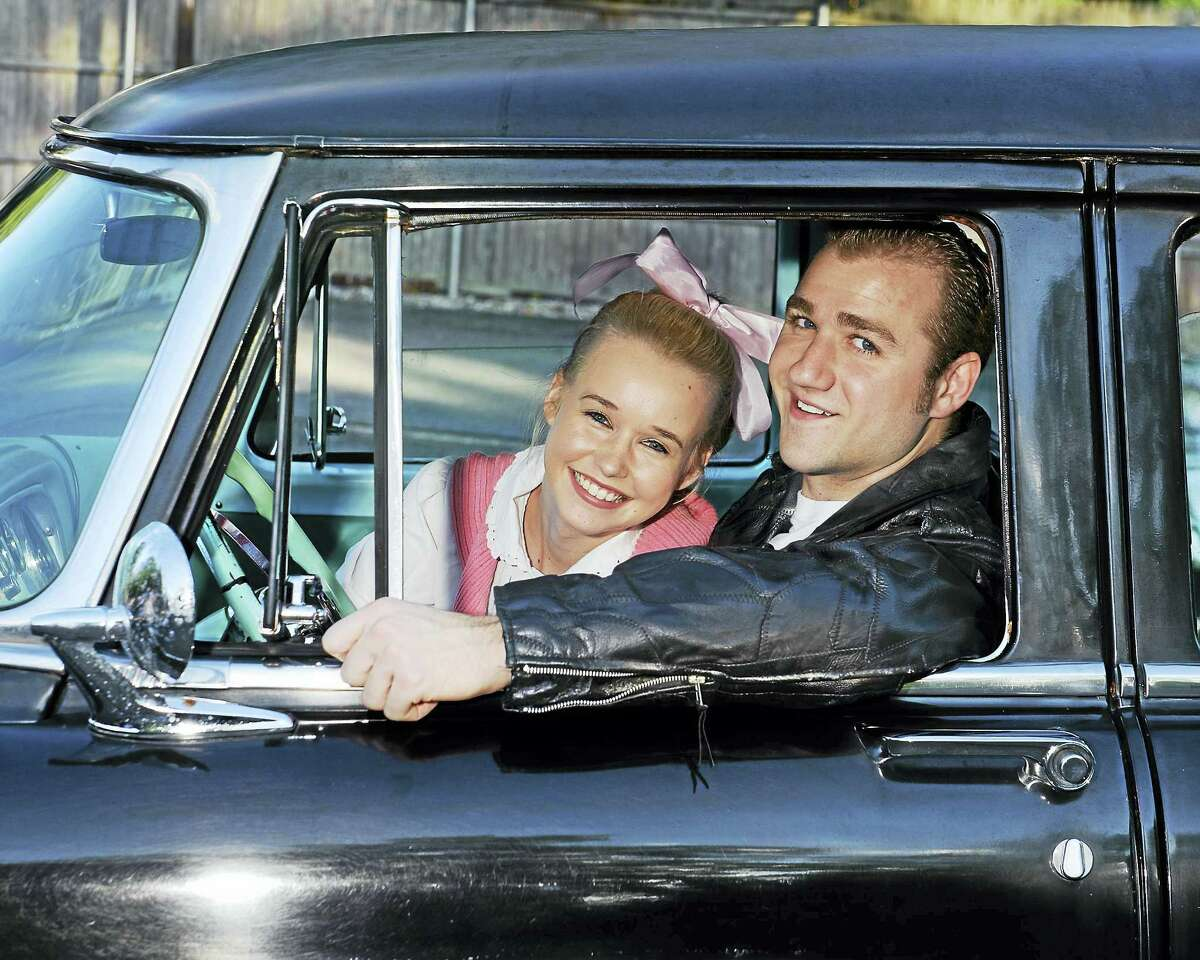 """Brittany Mulcahy and Rob Girardin star as Sandy and Danny in Landmark Community Theatre's production of """"Grease,"""" opening Saturday night at the Thomaston Opera House."""