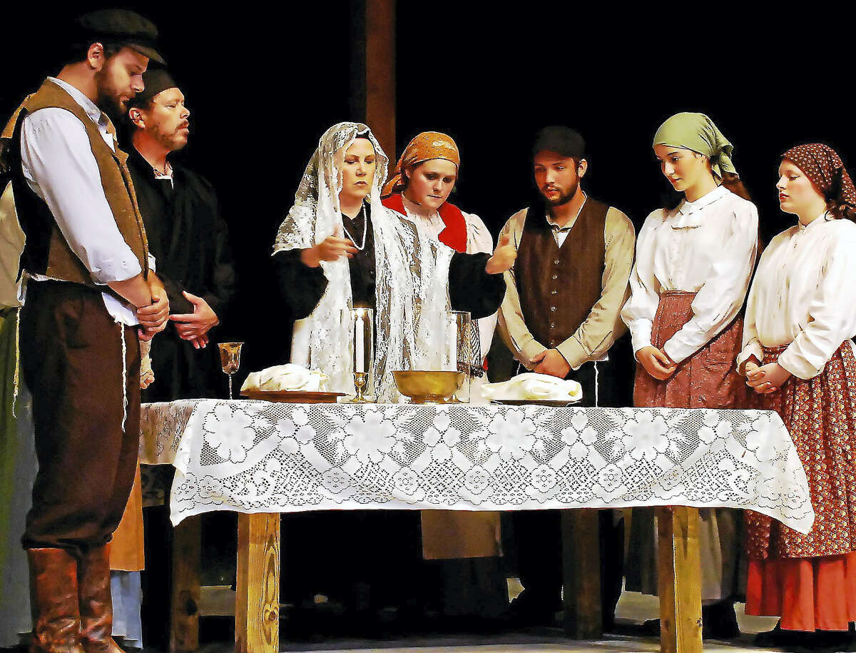 """The family gathers for the Sabbath in a scene from Clay & Wattles Theater Company's production of """"Fiddler on the Roof."""""""