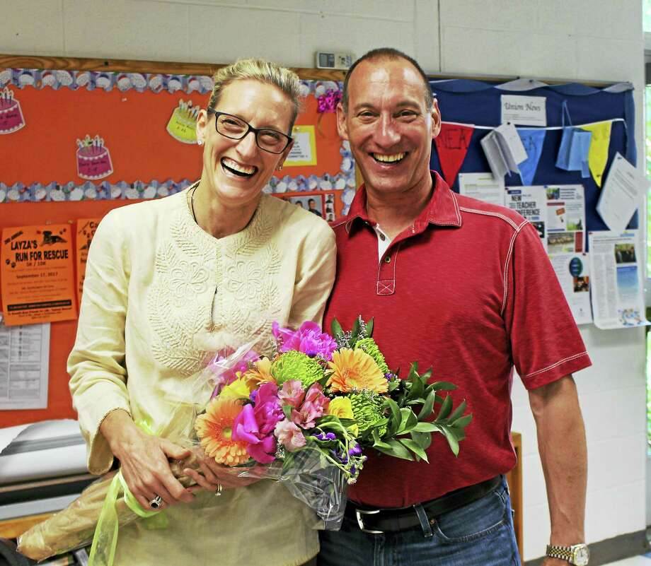 Patti Smaldone and her husband Mark were thrilled to learn she had been named Region 10's Teacher of the Year. Photo: Contributed Photo / Stephanie Cowger